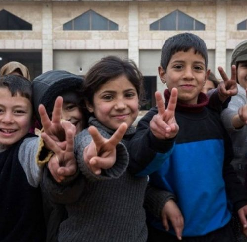Syrian children celebrate the victory in Aleppo