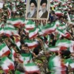 Millions celebrate the Revolution with the portraits of the revolutionary leaders: Khomeini and Khamenei