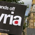 placard to oppose UK military involvement in Syria