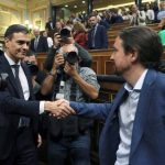 Pablo Iglesias welcomes the new Prime Minister Pedro Sanchez of the Socialist Party.