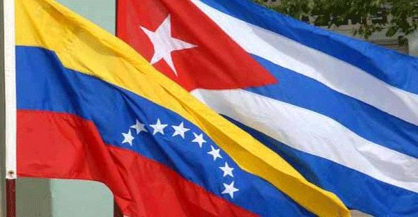 The Cuban and Venezuelan flags at a Solidarity Campaign demonstration