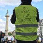 "The jacket of the Gilet Jaune reads: ""Our desires are taken for disorder"""