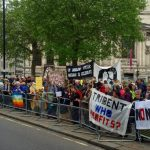 The demonstration was in July 2019. Banners say Trident, who benefits, and No Nukes
