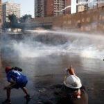 People are attacked with water and tear gas